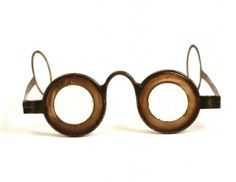 """A pair of Martin's Margin spectacles with temple arms in steel and horn, 1750-1760, United Kingdom. Benjamin Martin developed his glasses in the 1750s. They had reduced aperture lenses on account a thick horn margin which was not only an optical innovation but also created the highly  characteristic appearance of the frames which became known as """"Martin's Margins""""."""