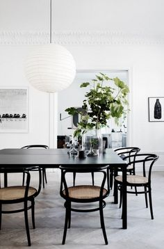 The white, Scandinavian appartment of Lotta Agaton. Love the black Thonet chairs.