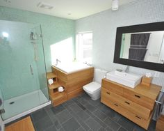 A #bathroomremodel with clean lines www.remodelworks.com