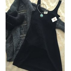 "NEW FREE PEOPLE Black Sparkle Dress S NWT. Intimately Free People short black dress. Sparkles when you move. Size small. Scoop front and back. Length 31"", bust 12.5"". Nylon, metallic and spandex material. Free People Dresses Mini"
