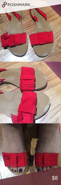 Cute red sandals size 7 1/2 This cute crepe satin red sandal size 7 1/2 and very comfy. Is in good condition minor scuff in the front a little stain on the strap. PLEASE ASK ALL QUESTIONS PRIOR TO PURCHASE. I AM NOT RESPONSIBLE FOR LOST OR DAMAGE PARCEL OR BUYERS DISSATISFACTION. Shoes Sandals