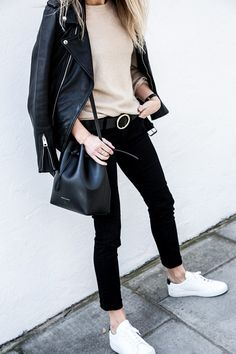 Blogger Lucy Williams wearing sweater by AG and jeans by AG. Don't like the bucket bag though.