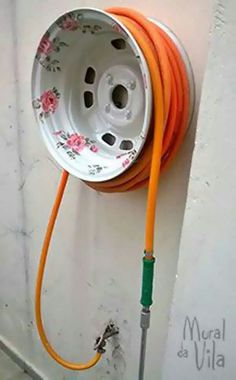 Old wheel rim repurposed as hose reel