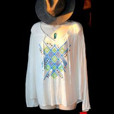 """Boho womens juniors white gauze top size M, NWT NWT Boho style, crinkle, gauze light-weight material top from Mossimo Supply Co.  Sleeves gather softly at wrists.  Shirt has teal, black, and neon yellow design on front.  The diamond shapes are reflective pieces of metal sewn into design.  Very cute and comfortable!  Size medium that measures about 25"""" long from shoulder to front bottom and about 25"""" bust lying flat.  *Like the hat and Juicy Couture handbag with shirt?  Bundle 2 or more items…"""