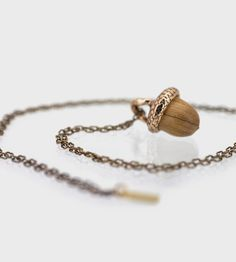 Acorns always make me think of possibility and beginnings. Such an adorable necklace. :: Acorn Wood  Bronze Necklace by Omerica Organic