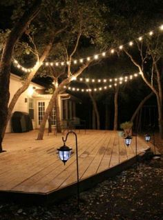 For The Back Part Of The Yard, Under All The Big Treesu0027 Wooden Deck,  Hammocks, A Seating Area And Strings Of Light