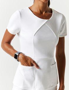 Envelope Pleat Top in White - Medical Scrubs by Jaanuu Dental Uniforms, Work Uniforms, Spa Uniform, Scrubs Uniform, Stylish Scrubs, Beauty Uniforms, Scrubs Outfit, Lab Coats, Uniform Design
