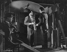 Joseph Cotten relaxes as Orson Welles receives direction from Carol Reed on the set of The Third Man, 1949.