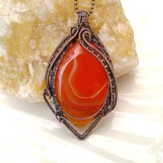 Handmade pendant with orange onyx agate in oxidized copper wire. Wire wrapped vintage jewelry. 3 1/4 X 1 7/8 inch ( 8.3 X 4.8 cm )