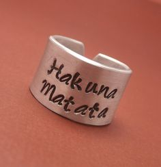 Lion King Inspired - Hakuna Matata - A Hand Stamped Aluminum Ring on Etsy, $13.95. I NEED THIS!