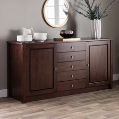 With nickel-finish hardware accenting a unique wenge finish, this classic wood buffet from Tribeca adds a touch of elegance to any room. Five drawers and two cabinets with adjustable shelves give you plenty of storage space for items of different sizes.