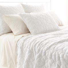Pine Cone Hill | Marina White Quilt | With its hand-stitched circular pattern on top-quality cotton, this quilt is lightweight and easygoing, yet has rich dimension and texture.