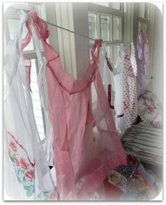 Gypsy Brocante: Porch of the month ....February - great ideas/beautiful pictures. #porchcurtains #vintageaprons #porch