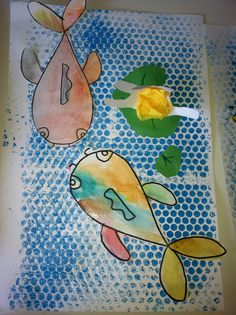 Koi fish project with bubble wrap printed background and a 3D lotus flower made from cut out hands