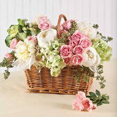 pink, white, soft green flower arrangement in a basket