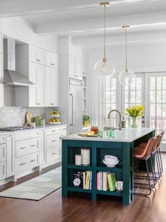 A timeless white kitchen with hanging clear pendants and a dark teal kitchen island. Teal Kitchen Cabinets, Green Kitchen Island, Kitchen Reno, Kitchen Colors, New Kitchen, Kitchen Remodel, Kitchen Dining, Kitchen Islands, Kitchen Ideas