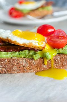Avocado Toast with Bacon and Eggs. Elevate ordinary avocado toast with some oven baked bacon and crispy fried egg - perfect for breakfast lunch dinner or entertaining! Best Egg Recipes, Pork Recipes, Cooking Recipes, Easy Recipes, Healthy Recipes, Best Avocado Toast Recipe, Avocado Recipes, Egg Recipes For Breakfast, Breakfast Lunch Dinner