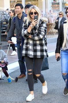 Tis the season of shopping: The Dancing With The Stars talent kept cozy with a black and w...