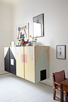 Cantilevered cabinet with painted houses, so lovely. #estella #kids #decor