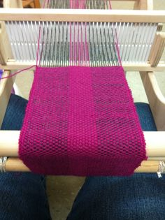 My first weaving project on my Cricket rigid heddle loom made out of Lion Brand wool - Magenta & Charcoal.