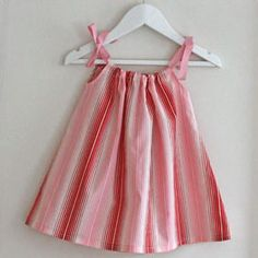 pillowcase style frock in tulip pink and red stripes. hello spring!