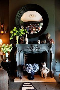 dark walls, black convex mirror, eclectic mantlescape, and bookshelves in the distance. Home Interior, Interior Decorating, Interior Design, Decorating Ideas, Decor Ideas, Black Wall Mirror, Faux Fireplace, Black Fireplace, Fireplace Mirror