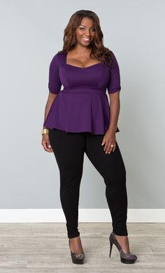 Be on-trend and get amazing shape with our Posh Ponte Peplum Top. Princess seams contour the bodice and a full skirt helps hide any tummy troubles. Designed with a cute simple ruched detail on the sleeves for that added touch. #MadeintheUSA #Kiyonna