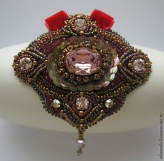 22 - Krisitina Adams is beadwork artist from Latvia. She makes amazing unusual bead embroidered brooches.