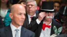 UNITED STATES - OCTOBER 04: Amanda Werner, who is dressed as Monopoly's Rich Uncle Pennybags, sits behind Richard Smith, left, CEO of Equifax, during a Senate Banking, Housing and Urban Affairs Committee hearing in Dirksen on the company's security breach on October 4, 2017.  (Photo By Tom Williams/CQ Roll Call)  Tom Williams/CQ Roll Call/Getty Images
