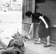 French woman pours tea to a British soldier during the fighting in Normandy 1944.