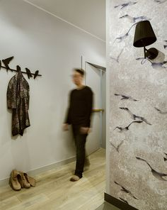 hall, grey hall, Louise Body Flight Chalk Stone wallpaper, wallpaper with birds, birds' hanger, black wall sconce