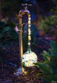 Learn how to craft these stunning DIY Waterdrop Solar Lights for your garden or walkway this spring! #solarlights #lantern #outdoors #diy #garden #homedecor #decorating #spring #crafts #gardencrafts #gardendiy #springcrafts #outdoorsdiy