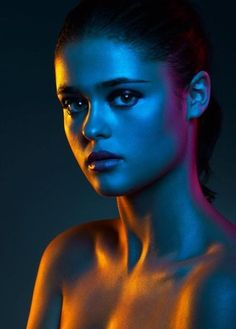 This portrait uses gel colours on the light box, this creates a colourful portrait as it shows up on the face.