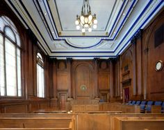 Frank E. Moss United States Courthouse. Three original courtrooms remain, as well as much of their original configuration and appearance.  There are two identical courtrooms, like the one shown, with full height dark stained red oak paneling, punctuated with Corninthian columns and pilasters, and original lighting and furniture.