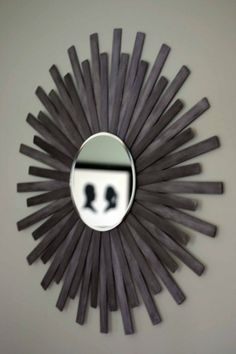 DIY paint stir stick sunburst mirror.  We have plenty of paint sticks if you need some! Just let us know and we can save them for you.