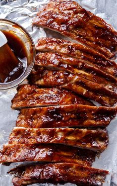 Slow Cooker Barbecue Ribs are melt-in-your-mouth incredible! Let your slow cooker do all the work and come home to sticky, fall apart ribs! Slow Cooker Barbecue Ribs easy and absolutely DELICIOUS! Fall-off-the-bone tender ribs finished off Low Carb Slow Cooker, Crock Pot Slow Cooker, Slow Cooker Recipes, Slow Cooker Ribs Recipe, Slow Cooker Barbecue Ribs, Barbecue Pork Ribs, Barbecue Sauce, Crockpot Pork Spare Ribs, Spare Ribs Slow Cooker