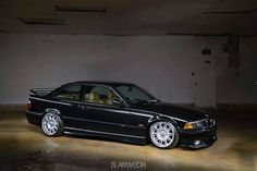 Black BMW e36 coupe on OEM BMW Styling 39 wheels