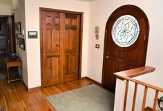 Entryway with solid wood door with leaded glass.