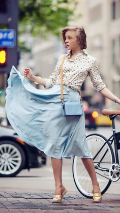 Street style - Pastel blue midi skirt. Is she wearing Toms?