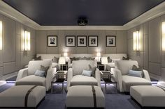 Achille Salvagni designed the screening room in this Southampton, New York, estate as a space where the whole family can indulge in their love for movies. The custom lounge chairs are upholstered in Dedar's Alexandre fabric, while the walls are covered in Dedar's Chambray. The Salvagni-designed Angel sconces are part of an edition of 20, available through Maison Gerard.