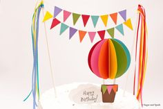 Above the Clouds : Colorful Rainbow Hot Air Balloon Cake Topper with Lacy Buntings Ribbon Accents - Red Pink Orange Yellow Green Blue Purple. $26.00, via Etsy.
