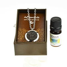 """Wrought Iron Essential Oil Diffuser Necklace Stainless Steel Locket Pendant with 24"""" Chain, oil, and pads in Gift Box -- Check out this great product. We are a participant in the Amazon Services LLC Associates Program, an affiliate advertising program designed to provide a means for us to earn fees by linking to Amazon.com and affiliated sites."""