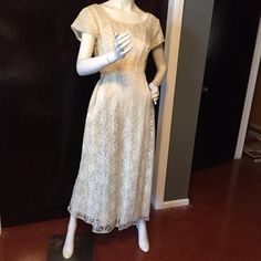 """Beautiful ivory vintage lace dress. Beautiful ivory vintage lace dress. Great condition. No tears or stains seen. Zipper in back. Bow is attached on one side and clasps on the other. Length 48"""", bust 38"""", waist 33"""". Size on dress states 16.5 however vintage sizes run small. Please see measurements for more accurate sizing. Vintage Dresses"""