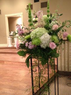 Ceremony floral to repurpose at the reception.