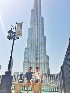 Gian and Marco in dubai with full height of building behind them