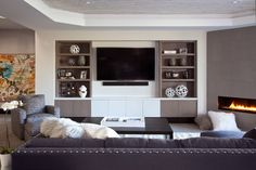 Plush textures and elegant accents define this living room completed by William Ohs. Built Ins, Decor, Elderly Home, Entertainment Center, Entertaining House, Contemporary Family Rooms, Entertainment Center Decor, Interior Design, Room