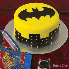Decorate a Batman cake for the Batman birthday party. Make this bat signal cake the best Batman birthday cake ever, and it's easy to decorate. Batman Birthday Cakes, Batman Cakes, Boy Birthday, Superhero Party Activities, Batman City, City Cake, Baby Batman, Seasonal Celebration, Cake Shapes