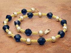 Golden Glimmer Choker-Gold is hotter than ever. Add the glimmer of Dark Indigo Blue Swarovski Crystals to this gold necklace to create a simple design with a lot of impact.