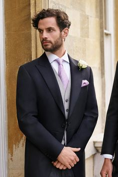 Calling all brides and grooms, look no further for groomsmen attire! If your wedding is a more formal affair, look no further than this classic groom's suit. The long-line, single-button jacket is cut away at the front to reveal the contrasting striped trousers. Finish the look properly with patent shoes and a coordinated buttonhole.