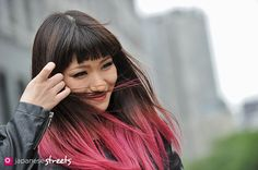 Japanese street fashion in Shibuya, Tokyo- I love the colors of her hair and the bangs